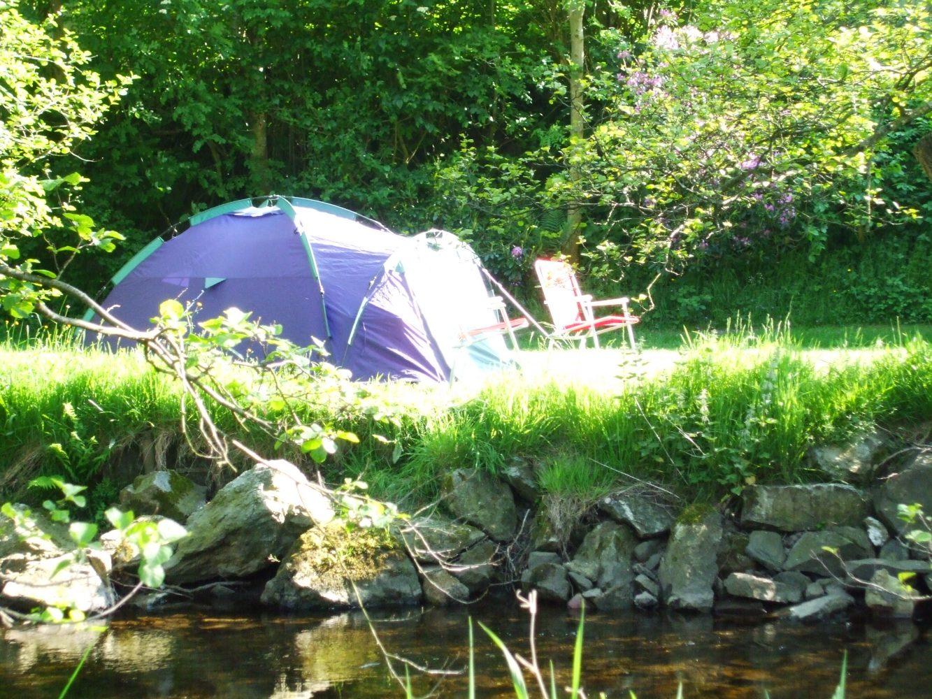 Camping along the riverbank